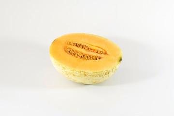Cantaloupe melon half cut sliced isolated on white background.