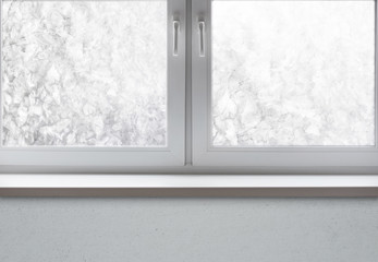 Part of the frozen window with snow ice  and sill