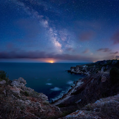 Milky Way above the sea / Long time exposure night landscape with Milky Way Galaxy above the Black sea and moonrise