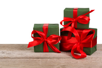 Birthday holiday gift boxes in wrapping paper on white wood