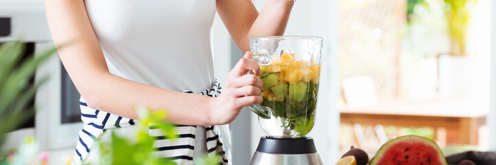 Healthy person preparing fruit cocktail