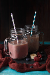 Picture of two jugs with milkshake with straw