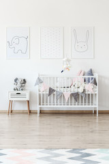 White baby's bed with banner
