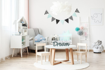 White kid's room with banner