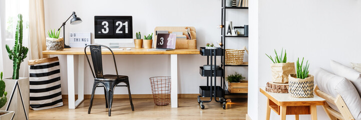 Black designed chair in workspace
