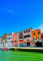 View of the Grand Canal and Venetian houses on a sunny day in Venice