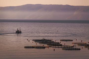 Fishing boat near fish farm in early morning on island Brac in Croatia