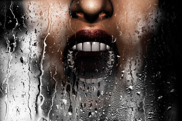 Steam room apocalypse,3d illustration of woman face screaming behind window glass with condensation effect,Horror background,mixed media