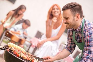 Photo sur Plexiglas Grill, Barbecue Family on vacation having barbecue