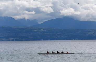 Rowers are pictured on Lake Leman in Lausanne