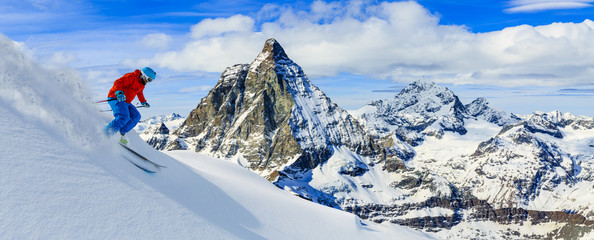 Wall Mural - Skiing with amazing view of swiss famous mountains in beautiful winter snow. Matterhorn, Zermatt, Swiss Alps.