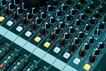 Close up of mixing panel sound working at recording studio. Vintage or retro tone.