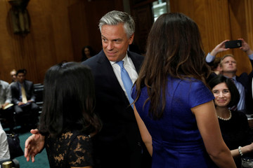 Former Governor Huntsman departs following a Senate Foreign Relations Committee hearing on his nomination to be ambassador to Russia on Capitol Hill in Washington