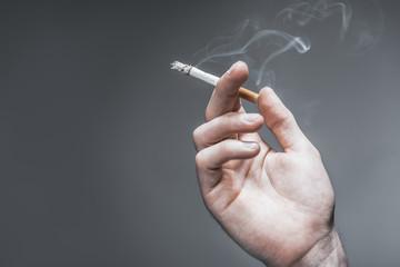 Arm of young man smoking