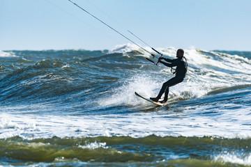 Kitesurfer riding ocean waves
