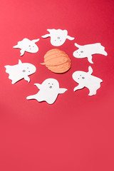 Traditional symbols of ghosts for haloween on red background