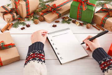 Christmas wish list on white wood table background