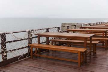 Photo of tables in coastal cafe by sea