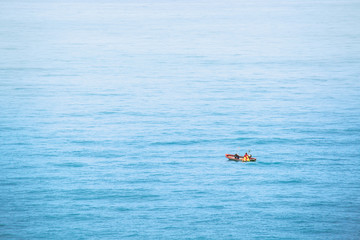 A small fishing boat floating in the beautiful sea.