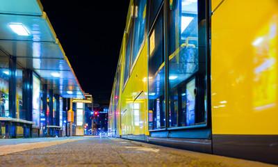 Berlin: modern tram stops at night / clean tram station / Trolley Metrotram / Metro Tram