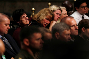 Family members of deceased U.S. Navy sailors wipe away tears during a Senate Armed Services Committee hearing on recent fatal U.S. Navy ship collisions at sea, on Capitol Hill in Washington