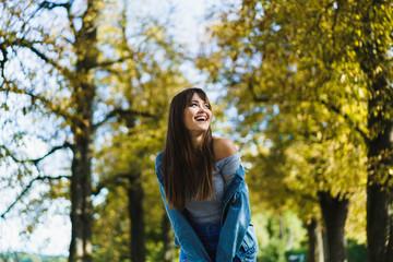 Cheerful woman walking in park