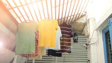 hang the clothes on the roof batten in house