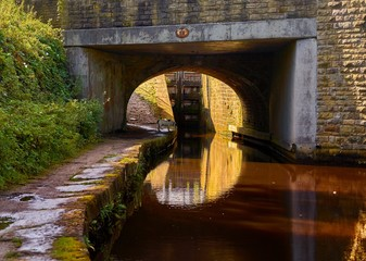 Bridge and lock on the Huddersfield Narrow Canal at Marsden, West Yorkshire, England