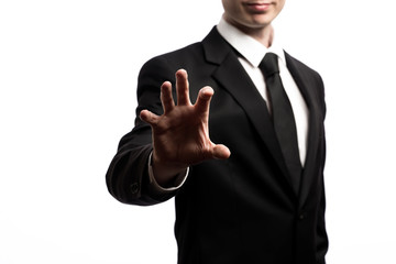Businessman pointing his fingers isolated on a white background