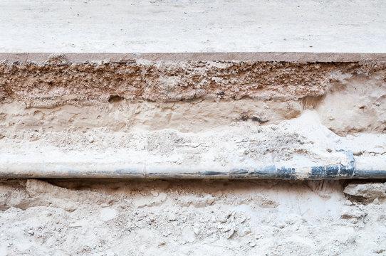 Old pipe excavation under the street asphalt
