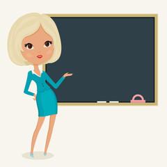 Teacher close to blackboard