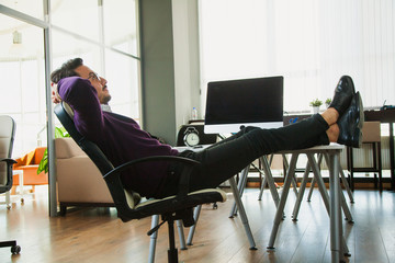 Male businessman have rest on his workplace