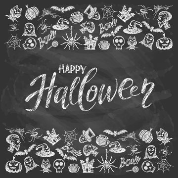 Happy Halloween with holiday decorations on black chalkboard background