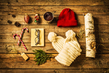 Christmas - scarf, hat, hot drink, book, candy canes and firewood