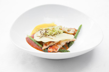 Gourmet ravioli with lobster and egg