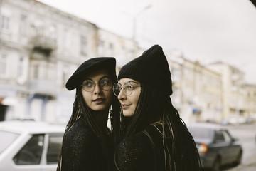 beautiful twins walking on the street