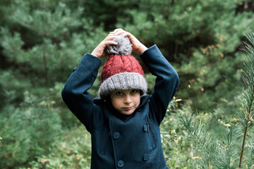 little boy with Christmas tree