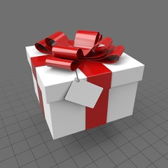Gift box with red bow and tag
