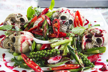 Stir-fry skulls with chili and pepper with blood, Halloween day food, Selective focus.