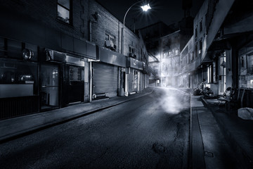 "Moody monochrome view of Doyers Street by night, in NYC Chinatown. The bend became known as ""the Bloody Angle"" because of numerous gang shootings."
