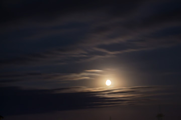 Moon, clouds over the village