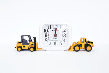 Forklift truck and front loader truck with white clock on white background, on time business concept