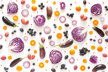 Fototapete - Composition of vegetables and fruits on a white background. Pattern made from fresh vegetables and fruits. Top view, flat design. Collage of red cabbage in a cut, eggplants, plums, grapes, mandarins.