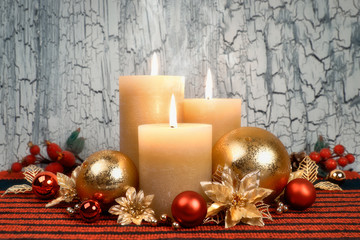 Christmas advent candles with golden and red decorations