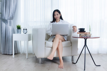 Portrait of Asian woman working at home. Woman living at home.