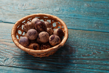 Image of blue table with quail eggs