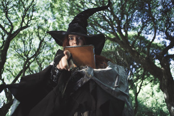 Image of witch in hat with book