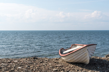 Small rowing boat by the coast