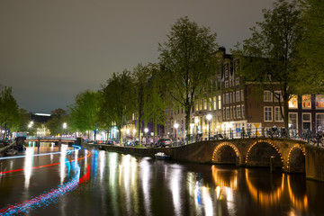 Poster Northern Europe Night view of Amsterdam cityscape with canal, bridge and houses in the evening