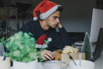 young student or worker at christmas working with the computer